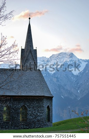 Chapel on a Mountainside in the Alps #757551445