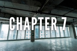 Chapter 7 bankruptcy text. Background is a gutted out interior of an office building.