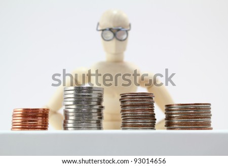 Character with glasses staring at stacks of US coins.