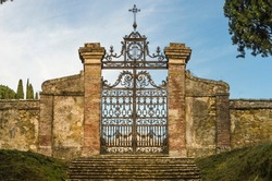 Characteristic gate of a public cemetery