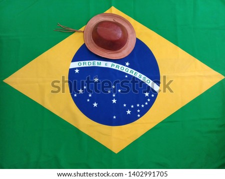 Characteristic hat of the Northeast region of Brazil and Brazilian flag background