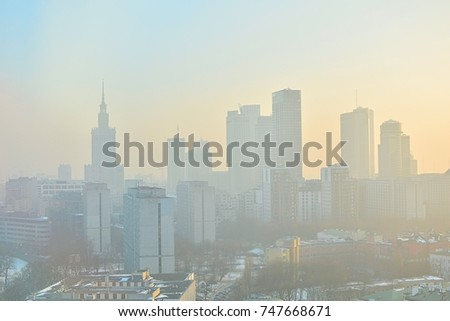 Characteristic view of a modern city skyline covered in a dense smog and pollution - Warsaw, Poland