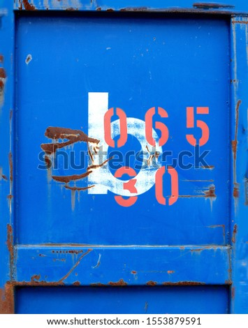 Characters on an iron container