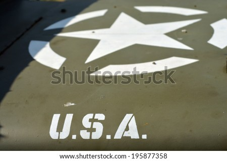 Characters USA and star on a old US army vehicle