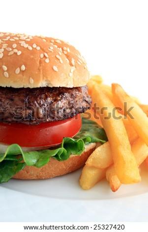 Charbroiled hamburger on sesame bun with fries