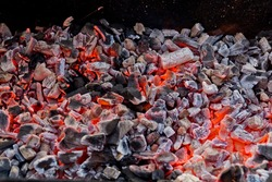 Charcoal burning.