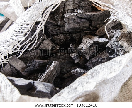 Charcoal for Thai cooking in the white sack.