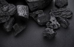 Charcoal on black floor