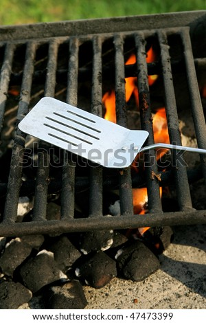 charcoal on fire heating up a barbecue pit before cooking - stock photo