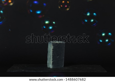Charcoal soap and soap bubbles