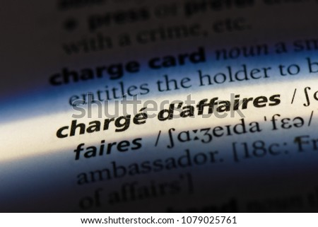 charge d affaires word in a dictionary. charge d affaires concept #1079025761