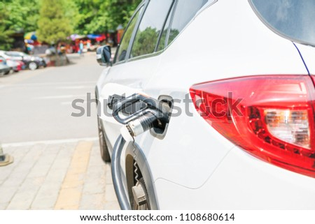 Charging car is charging #1108680614