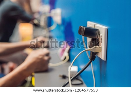 Charging mobile battery station in public area. Cellphone plug of electric power adapter in airport hall for all passengers. Free charger for devices. Copy space