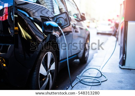 Charging modern electric car on the street which are the future of the Automobile - Shutterstock ID 548313280
