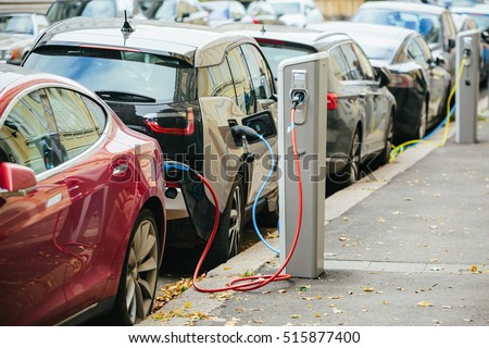 Charging modern electric cars (new energy vehicles, NEV) on the street station