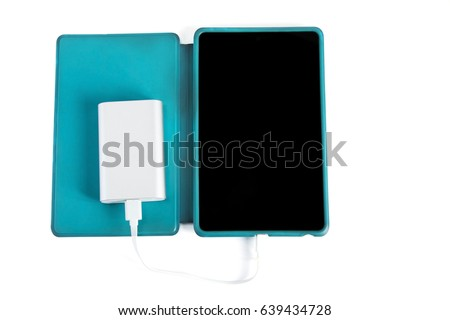 Charging tablet isolated on white background .