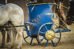 chariot race in a Roman circus, gladiators and slaves fighting