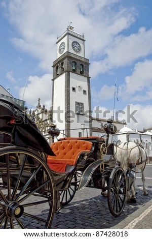 Chariot waiting for tourists at Sao Miguel main clock tower, Azores island at Portugal