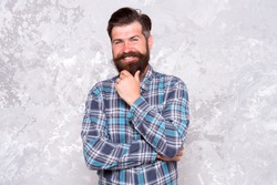 Charisma concept. Best beard design shape facial hair. Bearded hipster brutal guy. Nice beard distinguishable style that exuberant professionalism and manhood. Taking care of facial hair. Hair care.