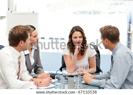 Charismatic businesswoman at a table with her team during a meeting