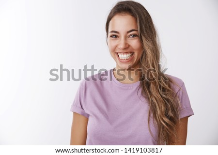 Charismatic carefree attractive healthy woman laughing out loud smiling white teeth giggling having fun, enjoying awesome friendly company watching comedy, chuckling funny joke, white background #1419103817