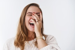 Charismatic carefree joyful friendly-looking outgoing woman likes laugh out loud not hiding emotions giggling hear funny hilarious joke chuckling facepalm close eyes smiling broadly white background