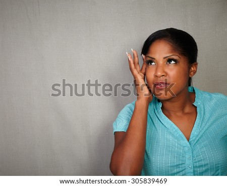 Charismatic young woman of african ethnicity having a headache - copy space