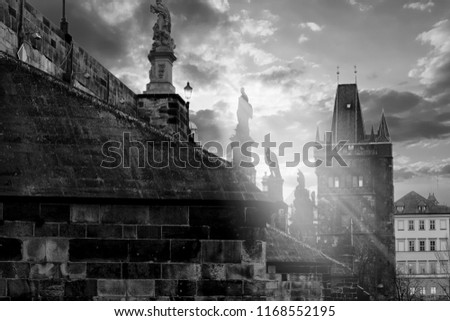 Charles Bridge in Prague at sunset hour with sun rays #1168552195