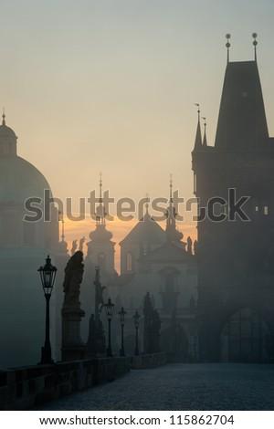 Charles bridge in Prague during misty morning
