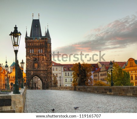 Charles bridge in Prague early in the morning at sunrise time