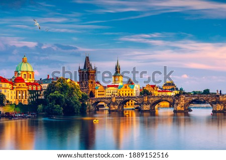 Charles Bridge in Prague in Czechia. Prague, Czech Republic. Charles Bridge (Karluv Most) and Old Town Tower. Vltava River and Charles Bridge. Concept of world travel, sightseeing and tourism. Stock photo ©