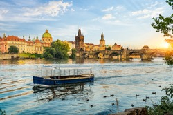 Charles Bridge on river Vltava in Prague at sunset