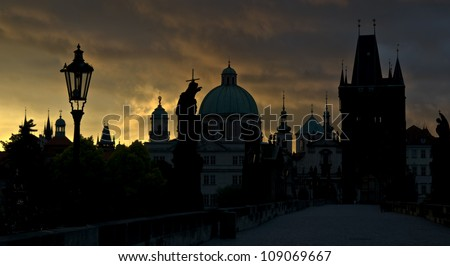 Charles bridge silhouette in Prague in the early morning, Czech Republic