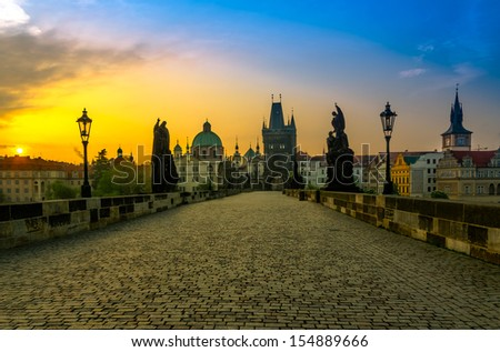Charles bridge with its statuette and the roofs of the building from Old Town, in Prague during the sunrise, Bohemia, Czech Republic
