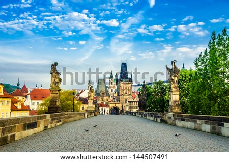 Charles bridge with its statuette, Lesser Town Bridge Tower and the tower of the Judith Bridge (which was Prague?s first stone bridge built in the first half of the 12th century (The Mala Strana).