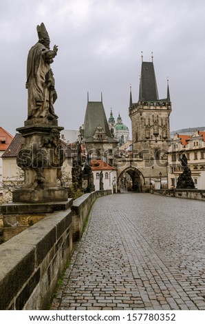 Charles bridge with its statuette, Lesser Town Bridge Tower and the tower of the Judith Bridge (which was Prague?s first stone bridge built in the first half of the 12th century (The Mala Strana)