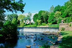 Charles River and waterfall in South Natick Dam Park Natick Massachusetts USA