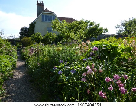 Charleston Farmhouse and restored garden in Firle East Sussex home to the Bloomsbury Group of artists writers and intellectuals