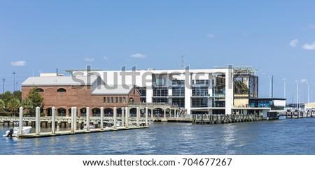 Charleston, South Carolina - August 23, 2017: A view of Fort Sunter Ferry Dock and Aquarium in Charleston, South Carolina, USA #704677267