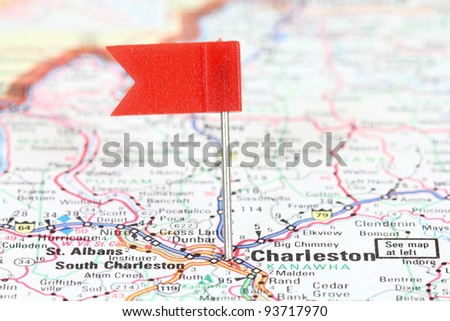 Charleston, West Virginia. Red flag pin on an old map showing travel destination.