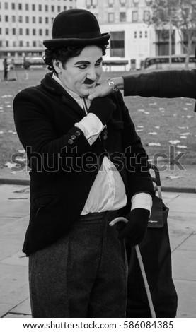 Charlie Chaplin kissing a women's hand B&W