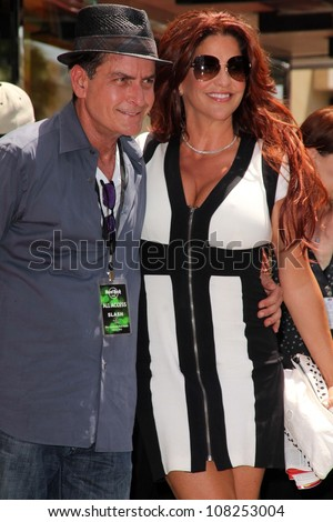 Charlie Sheen Perla Ferrar at Slash Honored with a Star on the Hollywood Walk of Fame Hollywood CA 07-10-12