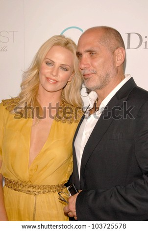 Charlize Theron and Guillermo Arriaga at the Los Angeles Premiere of 'Burning Plain'. Bond Street, Beverly Hills, CA. 09-14-09