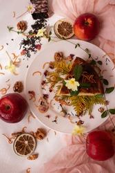 Charlotte apple pie decorated with orange peel