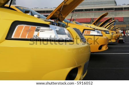 CHARLOTTE, NC - APRIL 6, 2008: Lowes Motor Sppedway. Yellow Mustang line up at Lowes Motor Speedway, April 6, 2008 in Charlotte, North Carolina.