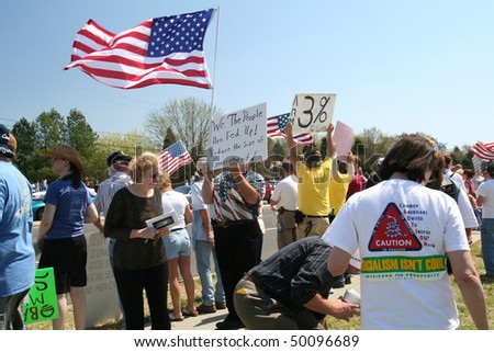 CHARLOTTE, NC - APRIL 2: Protesters on Good Friday. President Obama visits Charlotte NC to proclaim worst is over in the Economy. Citizens line the street in protest of government spending on April 2, 2010 in Charlotte, North Carolina