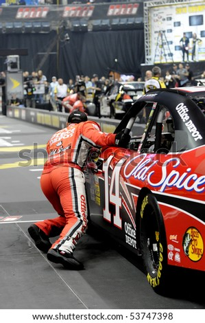 CHARLOTTE, NC - MAY 19 A crew member of the number 14 Office Depot car strains to pull the car to the finish line in the 2010 NASCAR Pit Crew Challenge MAY 19 2010 in CHARLOTTE NC