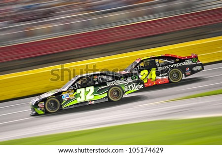CHARLOTTE, NC - MAY 27:  Jeff Gordon 24 is passing TJ Bell 32 at the Nascar Coca Cola 600  at Charlotte Motorspeedway in Charlotte, NC on May 27, 2012