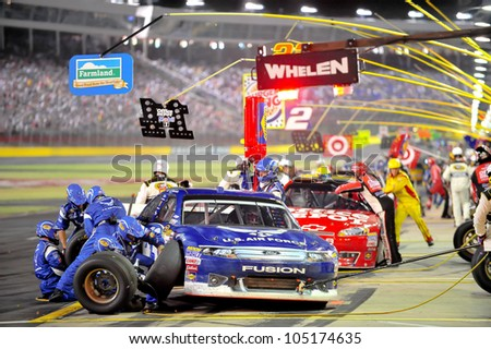 CHARLOTTE, NC - MAY 27:   pit stops for Aric Almirola (blue) and Tony Stewart at the Nascar Coca Cola 600  at Charlotte Motorspeedway in Charlotte, NC on May 27, 2012
