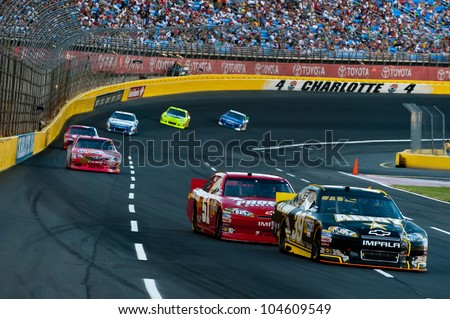 CHARLOTTE, NC - MAY 27: Ryan Newman leads Kurt Busch  at the Nascar Coca Cola 600  at Charlotte Motorspeedway in Charlotte, NC on May 27, 2012 - stock photo